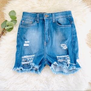 Fashion Nova medium wash distressed shorts